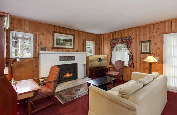 mendocino coast bed and breakfast with big river views, fireplace, red couch and queen bed